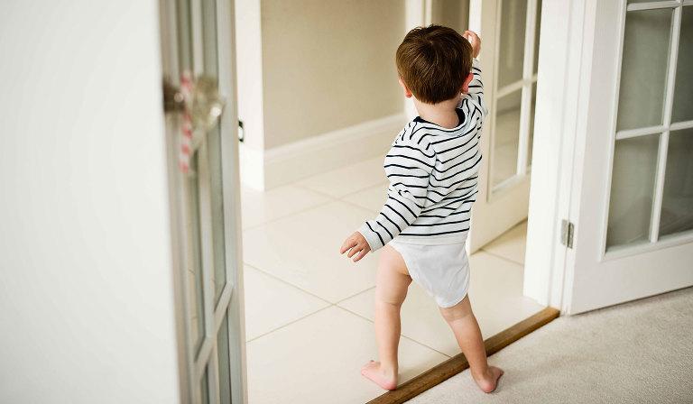 Toddler running around nappy-less
