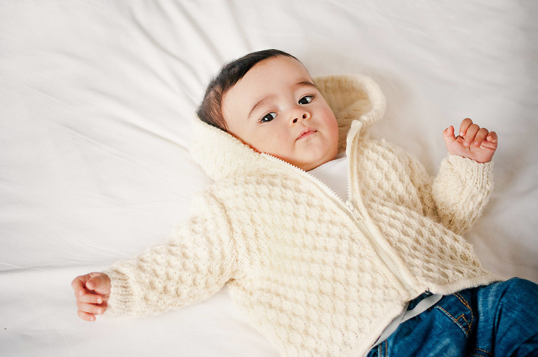Baby on cot bed