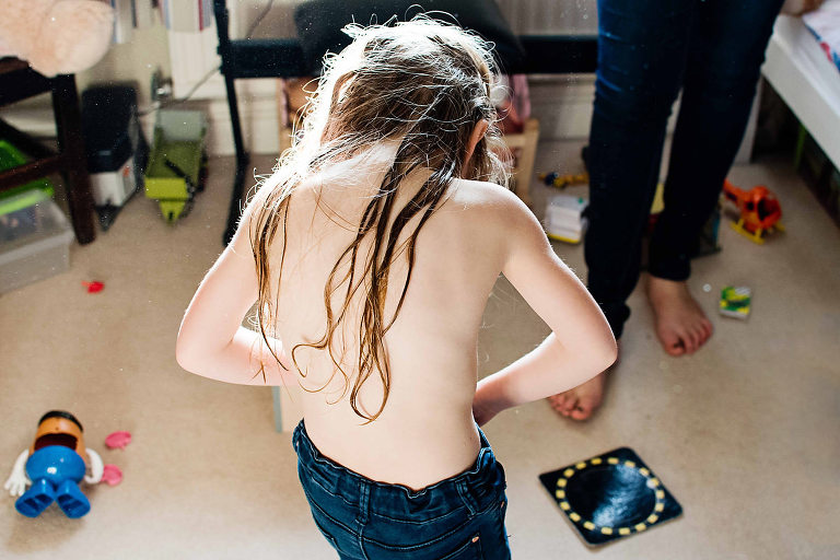 Young girl getting changed.