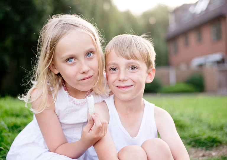 Photo of brother and sister captured outdoors by child photographer Kofo Baptist